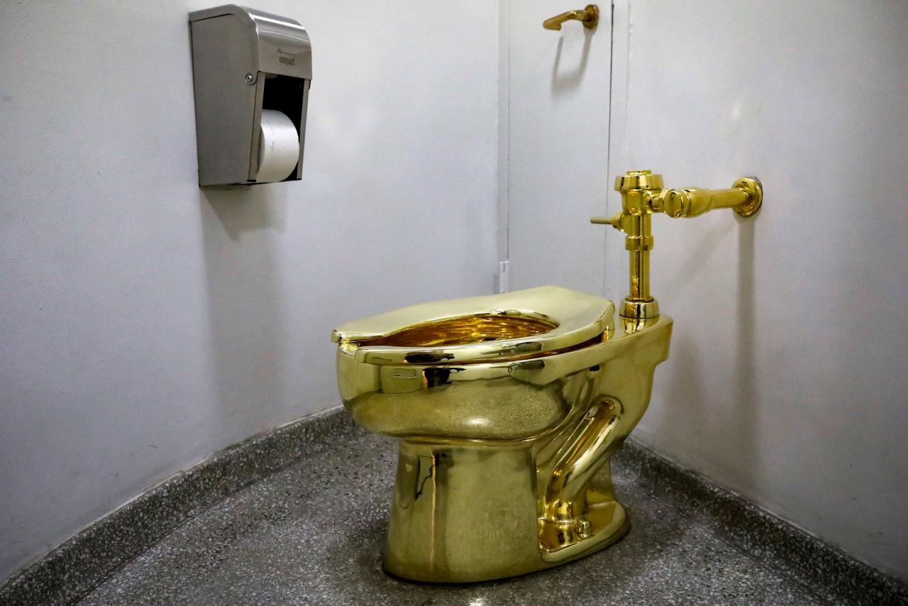 """FILE PHOTO:  Maurizio Cattelan's """"America,"""" a fully functional solid gold toilet is seen at The Guggenheim Museum in New York"""