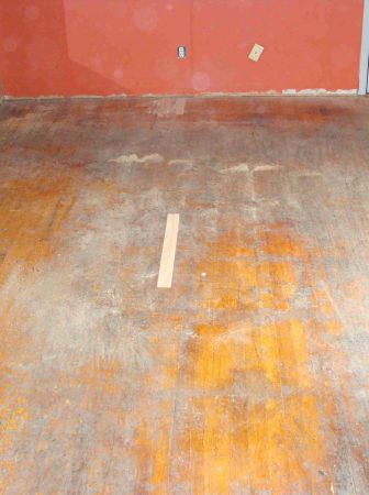 old-torn-scratched-dirty-flooring-in-need-of-replacement